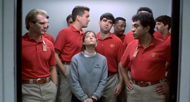 silence-of-the-lambs-1991-001-clarice-in-lift-surrounded-by-male-fbi-team-in-red_0